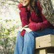 Stock Photo: Young woman reading outdoors