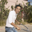 Young man riding a bicycle — Stock Photo