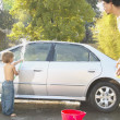 Father and young son washing car — Stock Photo