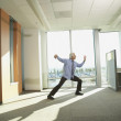 Businessman doing Tai Chi in the office — Stock Photo