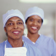 Stock Photo: Two female surgeons smiling