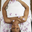 African woman laying on spa table — Foto Stock