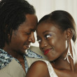 Close up of African couple hugging — Stock Photo