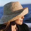 Stock Photo: Young womin hat viewing ocean