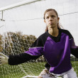 Girl goalie with mud on face - Stok fotoraf