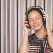Stock Photo: Filipino womlistening to headphones