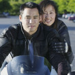 Portrait of couple riding motorcycle — Stock Photo