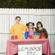 Mixed Race children selling lemonade — Stock Photo #13229904