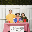 Stock Photo: Mixed Race children selling lemonade