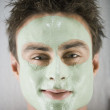 Close up of man smiling with spa facial treatment — Stock Photo