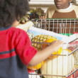 Young African American brothers pushing shopping cart — Stok fotoğraf