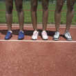 Stock Photo: Portrait of female track athletes legs