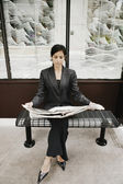 Businesswoman reading a newspaper — Stock Photo