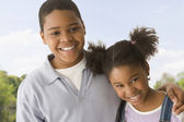 African American brother and sister hugging — Stock Photo