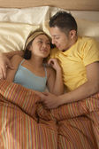 Couple in bed together — Stock Photo