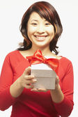Portrait of Asian woman holding gift — Stock Photo