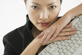Portrait of woman with keyboard — Stock Photo