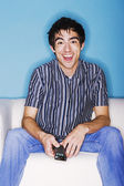 Young man watching television — Stock Photo