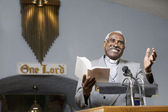 African American Reverend preaching in church — Stock Photo