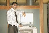 Businessman using copy machine — Stock Photo