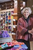 Woman in yarn shop — Stock Photo