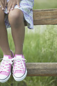 Low section of girl wearing pink shoes — Stock Photo