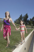 Senior woman and granddaughter walking together — Stock Photo