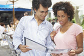 Young couple examining a menu — Stock Photo