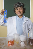 Young boy with science project holding first place ribbon — Stock Photo