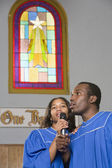 African American choir singing in church — Stock Photo