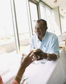 Senior African couple toasting at restaurant — Stock Photo