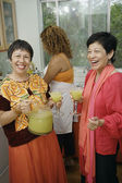 Women having mixed drinks — 图库照片