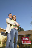 Portrait of couple at open house — Stock Photo