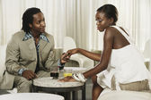 African couple holding hands at bar — Stock Photo