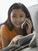 Portrait of young girl talking on phone — Stock Photo