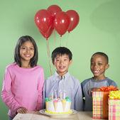 Multi-ethnic children at birthday party — Stock Photo