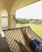 Father and son relaxing in a hammock — Stok fotoğraf