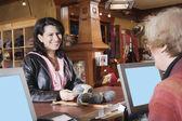 Female customer in yarn shop — Stock Photo