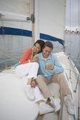 Couple enjoying their sailboat — Stock Photo
