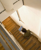 High angle view of man using laptop on stairs — Stock Photo