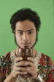 Portrait of man holding chalice — Stock Photo