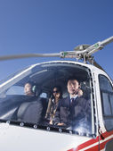 Asian businesspeople in helicopter — Stock Photo