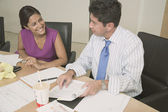 Hispanic businesspeople working at table — Stock Photo