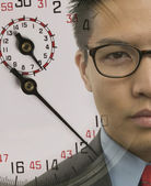 Young businessman with superimposed stopwatch image — Stock Photo