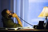 Hispanic businessman talking on telephone — Stock Photo