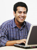 Young man typing on laptop — Stock Photo