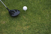 Still life of golf club and ball on the green — Stock Photo