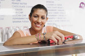Portrait of teenage girl working in ice cream shop — Stock Photo