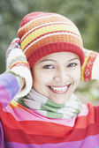 Young woman wearing a hat, scarf and gloves outdoors — Stock Photo