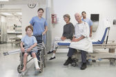 Healthcare professionals and patients posing in hospital setting — Stok fotoğraf